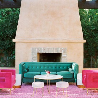 Pink and green lounge furniture is giving our Oran